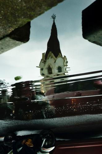 The Church - Refleksi air hujan di jalanan Kota Malang, Jawa Timur (Foto: Lydia Okva Anjelia)
